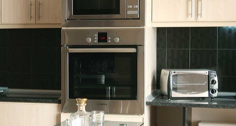 Siemens or Miele stainless steel Microwave Oven with 5-7 power levels upto 900W.